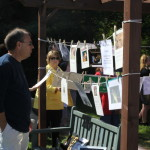 Hanging photos & other tributes is a tradition at this annual event