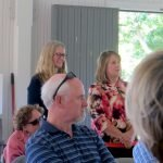 Dr.Katie Hilst and Shaun O'Keefe listen to the stories