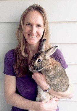 Vet Kitt Schaller holding one of her rabbits.