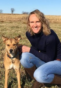 Vet Kitt Schaller next to one of her dogs